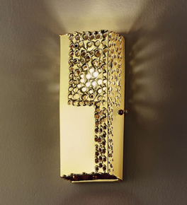 Forme Design gold wall light that has drill, flame cut & glass details