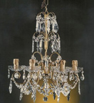 Antique 6 Light Chandelier With Multiple Crystal Drop Areas.