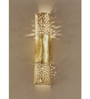 Forme design metal wall light that has drill & flame cut details