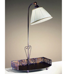 Caronte design curved tray hand worked metal floor lamp
